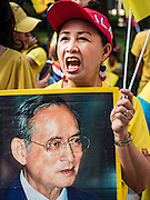 "05 DECEMBER 2015 - BANGKOK, THAILAND: A woman in the plaza at Siriraj Hospital shouts ""Long Live the King"" on the 88th birthday of Bhumibol Adulyadej, the King of Thailand. Hundreds of people crowded into the plaza hoping to catch a glimpse of the revered Monarch. The King has lived at Siriraj Hospital off and on for more than four years.     PHOTO BY JACK KURTZ"
