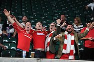 Wales fans celebrate their teams win at end of match. Rugby World Cup 2015 pool A match, England v Wales at Twickenham Stadium in London, England  on Saturday 26th September 2015.<br /> pic by  Andrew Orchard, Andrew Orchard sports photography.