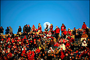 .A sea of red UNM fans try to stay warm as the moon begins to rise behind University Stadium. UNM defeated Nevada 23-0 in the New Mexico Bowl on Saturday, ending  a 46-year losing streak without a post season victory and gave 10th-year coach Rocky Long his first bowl win.