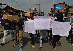 September 6, 2017 - India - Protesters hold placards as they march in old Srinagar,Kashmir on ,September 06,2017 against the killing of Rohingya muslims in Myanmar by the state military and the Buddhist majority (Credit Image: © Faisal Khan/Pacific Press via ZUMA Wire)