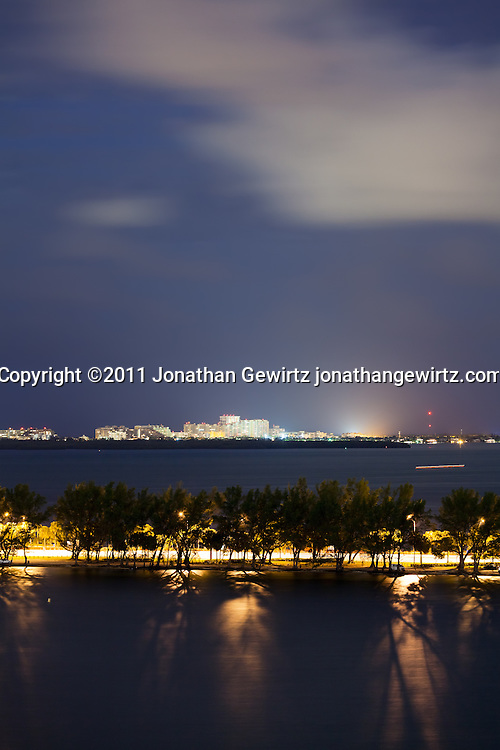 Night view of the residential area of Key Biscayne, Florida and the Rickenbacker Causeway as seen from across Biscayne Bay. WATERMARKS WILL NOT APPEAR ON PRINTS OR LICENSED IMAGES.
