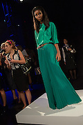 A green pants suit, with voluminous, emerald green pleated pants and a three-quarter sleeve top. By Monika Chiang at Spring 2013 Fashion Week in New York.