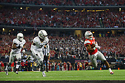 Ezekiel Elliott #15 of the Ohio State Buckeyes breaks free for a 9 yard touchdown run against the Oregon Ducks in the 3rd quarter of the College Football Playoff National Championship Game at AT&T Stadium on January 12, 2015 in Arlington, Texas.  (Cooper Neill for The New York Times)