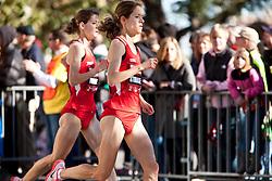 Tara and Kara Storage, twins, with quarter mile to go in women's marathon