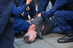 © Licensed to London News Pictures. 16/09/2021. London, UK. A protester is arrested by police officers  during an anti Lockdown and anti Covid vaccination demonstration calling for an end to mandatory vaccination passports and the vaccination of teenagers. Photo credit: London News Pictures