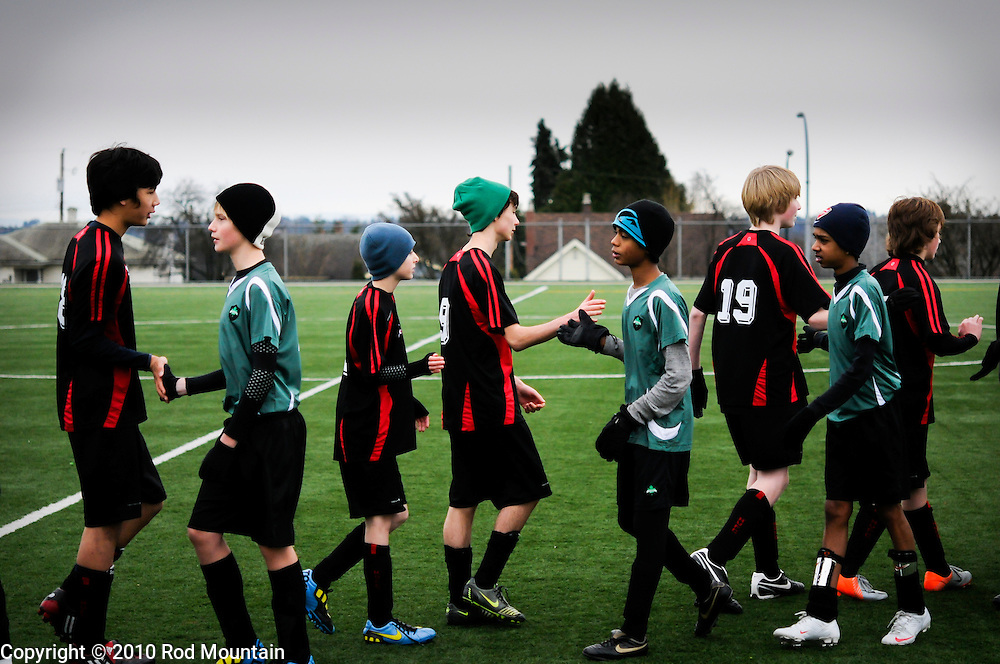Burnaby, BC, Canada - December 11, 2010 - A group of boys lineup after a Soccer match to shake hands with the other team. <br /> <br /> Photo: © Rod Mountain<br /> <br /> @rod_mountain<br /> <br /> http://www.rodmountain.com