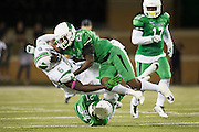 Marshall Thundering Herd tight end Emanuel Byrd (6) is tackled by the North Texas Mean Green during the 2nd half at Apogee Stadium in Denton, Texas on October 8, 2016. (Cooper Neill for The Herald-Dispatch)