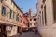 View of the tower of Basilica dei Frari, framed by the streets of Venice, Italy