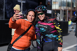 Tiffany Cromwell poses for a selfie with a fan at Liege-Bastogne-Liege Femmes - a 135.5 km road race between Bastogne and Ans on April 23 2017 in Liège, Belgium.