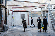 People walking in the Mea Sharim neighborhood of Jerusalem