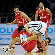 Anadolu Efes's Sasha Vujacic (C) and Olympiacos's Stratos Perperoglou (R), Vassilis Spanoulis (R), Kostas Sloukas (L) during their Turkish Airlines Euroleague Basketball Group C Game 2 match Anadolu Efes between Olympiacos at Abdi ipekci Arena in Istanbul, Turkey, Friday, October 19, 2012. Photo by TURKPIX