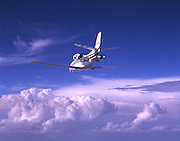 Cessna Citation Excel flying above the clouds.
