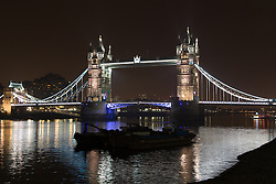 © Licensed to London News Pictures. 29/03/2014. London, UK. Tower Bridge, with lights on, just before turning off the lights in support of global Earth Hour 2014 at 8:30pm local time on 29th March 2014. Photo credit : Vickie Flores/LNP