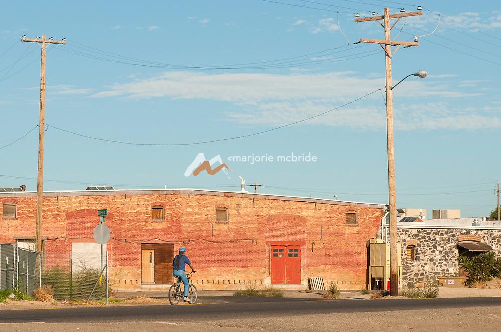 Old man biking in historic downtown Twin Falls, Idaho.