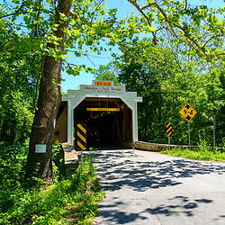 Phoenixville, PA, USA - June 14, 2020: The Sheeder-Hall  Bridge is a 100-foot-long covered bridge in Chester County. It crosses French Creek and was constructed in 1850.