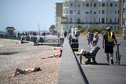 © Licensed to London News Pictures. 03/07/2018. Hove, UK. Members of the public enjoy the warm weather on the seafront at Hove, East Sussex on the south coast of England, as a heatwave continues across the UK. Photo credit: Ben Cawthra/LNP