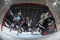 KELOWNA, CANADA - JANUARY 18: Nick Merkley #10 of the Kelowna Rockets is blocked by Brett Howden #21 in front of the net of Brody Willms #35 of the Moose Jaw Warriors on January 18, 2017 at Prospera Place in Kelowna, British Columbia, Canada.  (Photo by Marissa Baecker/Shoot the Breeze)  *** Local Caption ***