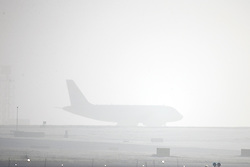 © Licensed to London News Pictures. 06/02/2017. Leeds UK. Aircraft are barely visible this morning at Leeds Bradford airport as Yorkshire woke to a thick covering of fog. Photo credit: Andrew McCaren/LNP