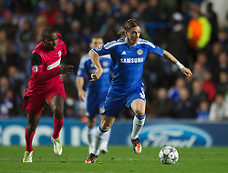LONDON, ENGLAND - Wednesday, October 19, 2011: Chelsea's Fernando Torres in action against Racing Genk's Khaleem Hyland during the UEFA Champions League Group E match at Stamford Bridge. (Photo by Chris Brunskill/Propaganda)