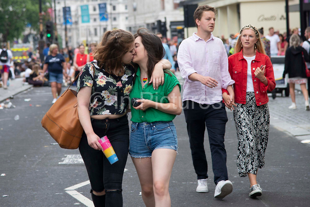 A couple kiss as members of the Lesbian, Gay, Bisexual and Transgender (LGBT) community take part in the annual Pride Parade on 6th July, 2019 in London,United Kingdom. (photo by Claire Doherty/In Pictures via Getty Images)