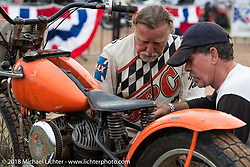 George Will with mc race tuner Marty MacCollum Portrait, The Spirit of Sturgis antique motorcycle flat track race at the historic Sturgis Half Mile during the 78th annual Sturgis Motorcycle Rally. Sturgis, SD. USA. Monday August 6, 2018. Photography ©2018 Michael Lichter.