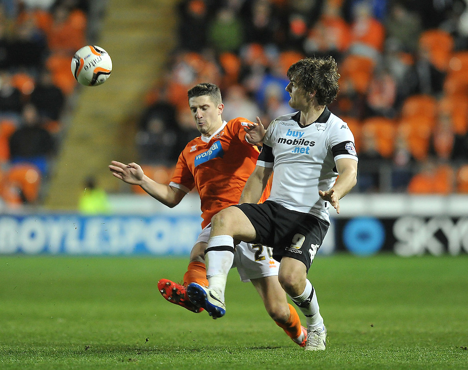 Blackpool's Craig Cathcart battles with Derby County's Chris Martin<br /> <br /> Photo by Dave Howarth/CameraSport<br /> <br /> Football - The Football League Sky Bet Championship - Blackpool v Derby County - Tuesday 8th April 2014 - Bloomfield Road - Blackpool<br /> <br /> © CameraSport - 43 Linden Ave. Countesthorpe. Leicester. England. LE8 5PG - Tel: +44 (0) 116 277 4147 - admin@camerasport.com - www.camerasport.com
