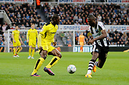 Burton Albion striker Marvin Sordell (9) and Newcastle United defender Chancel Mbemba (18) during the EFL Sky Bet Championship match between Newcastle United and Burton Albion at St. James's Park, Newcastle, England on 5 April 2017. Photo by Richard Holmes.