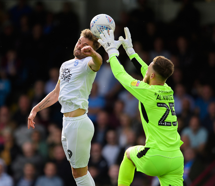 Peterborough United's Matthew Godden vies for possession with Scunthorpe United's Jak Alnwick<br /> <br /> Photographer Chris Vaughan/CameraSport<br /> <br /> The EFL Sky Bet League One - Scunthorpe United v Peterborough United - Saturday 13th October 2018 - Glanford Park - Scunthorpe<br /> <br /> World Copyright © 2018 CameraSport. All rights reserved. 43 Linden Ave. Countesthorpe. Leicester. England. LE8 5PG - Tel: +44 (0) 116 277 4147 - admin@camerasport.com - www.camerasport.com