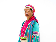 Paluang woman Hin 45 was born in Myanmar in Baan Tong Luang, Eco-Agricultural Hill Tribes Village on 7th June 2016 in Chiang Mai province, Thailand. The fabricated village is home to 8 different hill tribes who make a living from selling their handicrafts and having their photos taken by tourists.