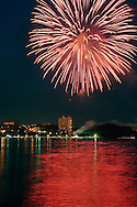 Highland, N.Y. - Fireworks burst above the Hudson River as part of the Mid-Hudson Hot Air Balloon Festival in Poughkeepsie, N.Y., on July 8, 2006.