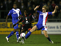Photo: Paul Greenwood/Sportsbeat Images.<br />Carlisle United v Swindon Town. Coca Cola League 1. 04/12/2007.<br />Swindon's Miguel Comminges, (c) battles for the ball with Chris Lumsdon