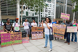 London, UK. 10 July, 2019. Antonia Bright of Movement for Justice addresses a protest outside the Home Office against the government department's decision to try to block the return to the UK of PN, a Ugandan lesbian removed from the UK using the now unlawful fast track procedure in 2013 but who the High Court ordered on 24th June must be returned to the UK by the Home Office after the handling of her case was ruled to be 'procedurally unfair'.