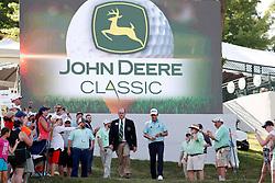 Jul 15, 2018; Silvis, IL, USA; PGA golfer Michael Kim walks to the 18th green for the trophy presentation after winning the John Deere Classic golf tournament at TPC Deere Run. Mandatory Credit: Brian Spurlock-USA TODAY Sports