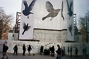 Bird theme construction theme hoarding in central London. During the renovation of this large building on the western end of Leicester Square, developers have designed the hoarding to reflect pigeon population long residing in this quarter of inner London. Although the feeding of birds is nowadays discouraged, tourists still drop crumbs and so pigeons still thrive, though not in the previous numbers of years ago.