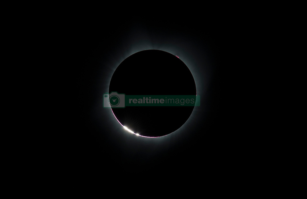 The Bailey's Beads  effect is seen as the moon makes its final move over the sun during the total solar eclipse on Monday, August 21, 2017 above Madras, Oregon. A total solar eclipse swept across a narrow portion of the contiguous United States from Lincoln Beach, Oregon to Charleston, South Carolina. A partial solar eclipse was visible across the entire North American continent along with parts of South America, Africa, and Europe.  Photo Credit: (NASA/Aubrey Gemignani)