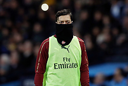 Arsenal's Mesut Ozil looks dejected after the final whistle during the Premier League match at the Etihad Stadium, Manchester.