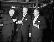 """26/01/1962<br /> 01/26/1962<br /> 26 January 1962<br /> Crew members of the British Railways vessel """"Cambria"""" touring W.D. and H.O. Wills factory, Dublin. (l-r): Mr. Ben Parry, Acting Catering Superintendent, British Railways, Marine, Holyhead; Mr T.W.W. Irvine, Factory Manager and Mr. E.A. Williams, Wills Representative in Dublin."""