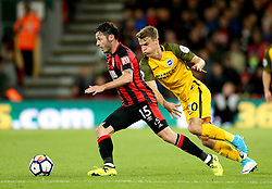 eAFC Bournemouth's Adam Smith (left) and Brighton & Hove Albion's Solly March battle for the ball