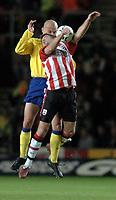 Photo: Richard Lane.<br />Southampton v Arsenal. Barclaycard Premiership.<br />29/12/2003.<br />James Beattie is challenged by Pascal Cygan.