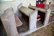 Interior of Saint Nicholas chapel, Gipping, Suffolk, England, UK historic font, pews, fifteenth century benches