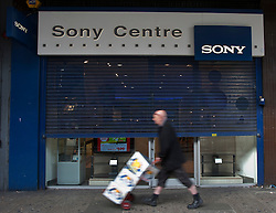 © licensed to London News Pictures. London, UK 12/04/2012. A man with a trolley walking past a Sony Centre in Wood Green. Sony was reported to be looking to shed 10,000 jobs worldwide this year as the company losses £4.2bn this year. Photo credit: Tolga Akmen/LNP