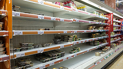 © Licensed to London News Pictures. 01/10/2021. London, UK. Nearly empty shelves of pre cooked meat products in Sainsbury's, north London, amid fears of food supplies shortages over Christmas. UK food producers and supermarkets are warning that shoppers are likely to face product shortages in the coming weeks after thousands of EU nationals quit their jobs as truck drivers in the UK following Brexit. According to the government, 5,000 heavy truck drivers and 5,500 poultry workers will be given working visas until Christmas 2021. Photo credit: Dinendra Haria/LNP