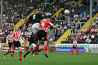 Photo: Pete Lorence.<br />Lincoln City v Milton Keynes Dons. Coca Cola League 2. 16/09/2006.<br />Clive Platt heads the ball into the back of the net and takes the Dons into a 3-1 lead.