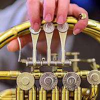 042015  Adron Gardner/Independent<br /> <br /> Dimes dot the French horn valves as Sharon Wilkins plays along with the Gallup Music Teacher's Ensemble at Gallup Middle School Monday.