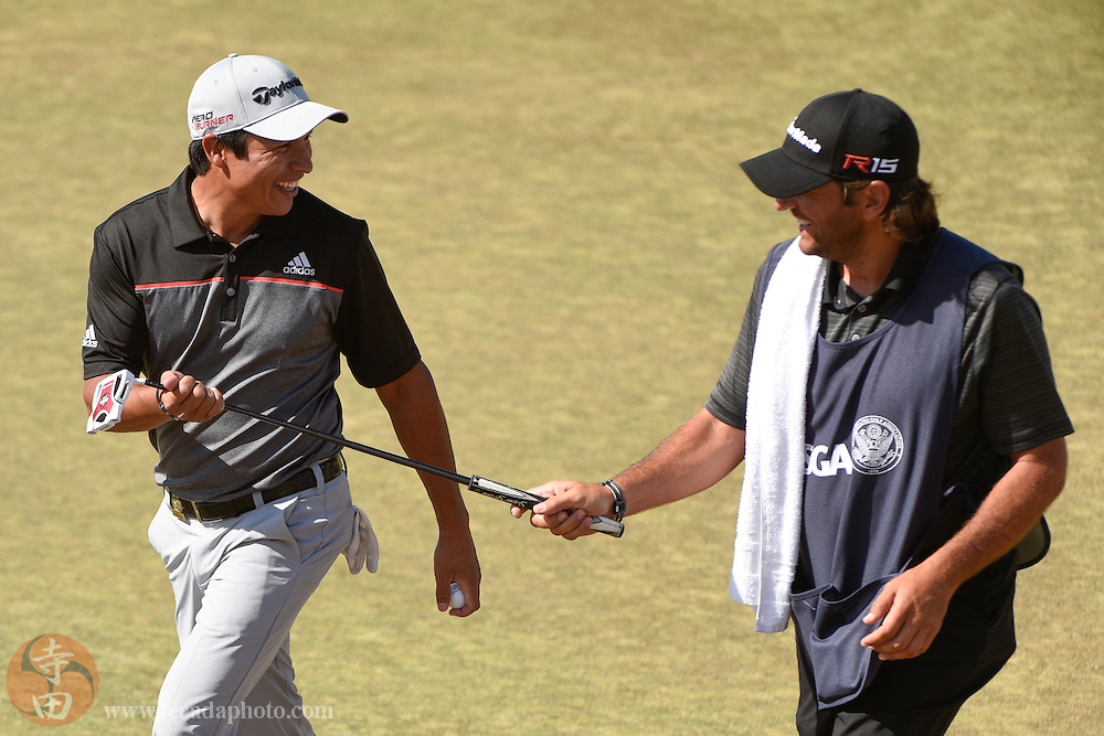 June 19, 2015; University Place, WA, USA; Andres Romero (left) smiles with caddie Angel Monguzzi (right) on the second hole in the second round of the 2015 U.S. Open golf tournament at Chambers Bay.