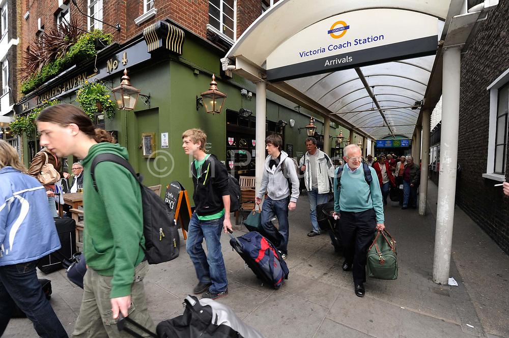 Travellers affected by the air travel ban arrive at Victoria coach station in London, UK after travelling from France to Dover. Many citizens were stranded abroad by the closure of much of European airspace because of the plume of ash from an Icelandic volcano.