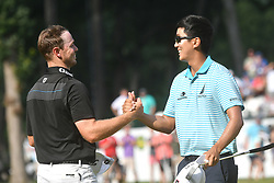 July 15, 2018 - Silvis, Illinois, U.S. - SILVIS, IL - JULY 15:  Michael Kim shakes hands with Bronson Burgoon after winning  the John Deere Classic on July 15, 2018, at TPC Deere Run, Silvis, IL.  (Photo by Keith Gillett/Icon Sportswire) (Credit Image: © Keith Gillett/Icon SMI via ZUMA Press)