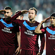 Trabzonspor's Burak YILMAZ (L), Remzi Giray KACAR (C) and Gustavo COLMAN (R) during their Turkish soccer superleague match Bursaspor between Trabzonspor at Ataturk Stadium in Bursa Turkey on Saturday, 22 October 2011. Photo by TURKPIX