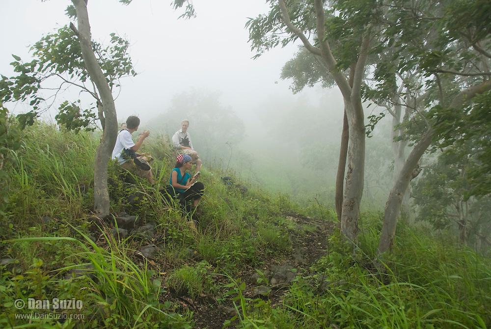 Herpetologist Mark O'Shea and American students take a break during a hike on Atauro Island, Timor-Leste (East Timor)