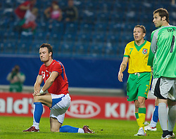 TEPLICE, CZECH REPUBLIC - SATURDAY, SEPTEMBER 2nd , 2006: Wales' Craig Bellamy looks on as Czech Republic's Martin Jiranek looks dejected after scoring an own goal to hand Wales an equaliser during the opening UEFA Euro 2008 Group D qualifying match at the Na Stinadlech Stadium. (Pic by David Rawcliffe/Propaganda)